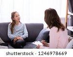 girl sitting on sofa explaining ... | Shutterstock . vector #1246978669