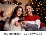 happy young couple with wine in ... | Shutterstock . vector #1246994176