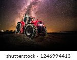 red tractor with colorful... | Shutterstock . vector #1246994413