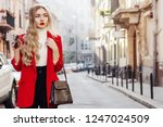 outdoor fashion portrait of... | Shutterstock . vector #1247024509
