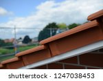 red roof verge tile with free... | Shutterstock . vector #1247038453