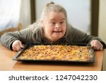 handicapped woman with home... | Shutterstock . vector #1247042230