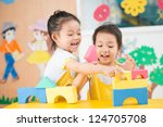 two girls playing in the studio | Shutterstock . vector #124705708