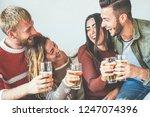 group of happy friends cheering ... | Shutterstock . vector #1247074396