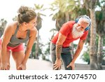 fit couple of friends having a... | Shutterstock . vector #1247074570