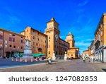 Castle Estense (Castello Estense) and piazza Savonarola and monumet to Savonarola in Ferrara, Emilia-Romagna, Italy. Ferrara is capital of the Province of Ferrara