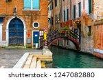 narrow canal with bridge in... | Shutterstock . vector #1247082880