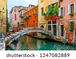 Narrow Canal With Bridge In...
