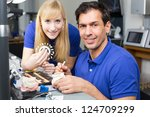 two dental technicians with... | Shutterstock . vector #124709299