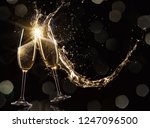 glasses of champagne levitating ... | Shutterstock . vector #1247096500