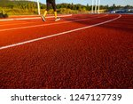 red running track with runner's ... | Shutterstock . vector #1247127739