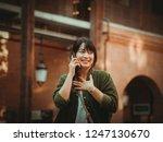 asian woman using smartphone...   Shutterstock . vector #1247130670