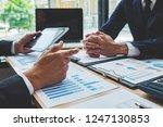 business team meeting present.... | Shutterstock . vector #1247130853