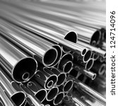 stack of steel  pipes. | Shutterstock . vector #124714096