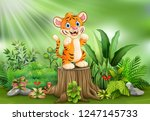 cartoon of a tiger standing on... | Shutterstock .eps vector #1247145733