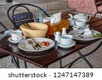 dining table after dinner.... | Shutterstock . vector #1247147389