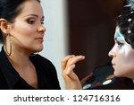 make up artist creating art... | Shutterstock . vector #124716316
