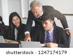 boss mentoring to intern... | Shutterstock . vector #1247174179