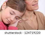 little girl resting on her... | Shutterstock . vector #124719220