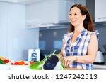 beautiful woman standing in the ... | Shutterstock . vector #1247242513