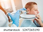 medical ear washing with water... | Shutterstock . vector #1247265190