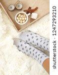 woman feet in polka dot socks...   Shutterstock . vector #1247293210
