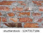 old obsolete red brick wall... | Shutterstock . vector #1247317186