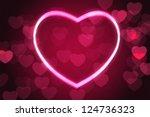 glowing heart shape with bokeh... | Shutterstock . vector #124736323
