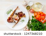 fried lamb ribs on white plate... | Shutterstock . vector #1247368210