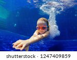 happy family in swimming pool.... | Shutterstock . vector #1247409859