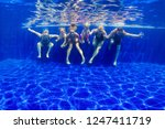 happy family in swimming pool.... | Shutterstock . vector #1247411719