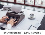 men's hands typing on a retro... | Shutterstock . vector #1247429053