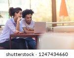 interracial couple using tablet ... | Shutterstock . vector #1247434660