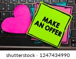 Small photo of Text sign showing Make An Offer. Conceptual photo Proposal Bring up Volunteer Proffer Bestow Bid Grant Papers Romantic lovely message Heart Keyboard Type computer Good feelings.