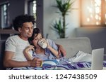 young couple watching a movie... | Shutterstock . vector #1247438509