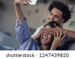 attractive couple sitting on... | Shutterstock . vector #1247439820