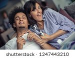 young couple enjoying playing... | Shutterstock . vector #1247443210