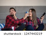 couple fighting for remote... | Shutterstock . vector #1247443219