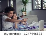 young couple watching a movie... | Shutterstock . vector #1247446873