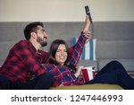 couple fighting for remote... | Shutterstock . vector #1247446993