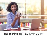 businesswoman using phone while ... | Shutterstock . vector #1247448049