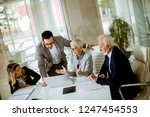 group of businesspeople in... | Shutterstock . vector #1247454553
