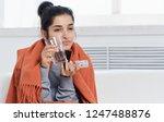 ailing woman drinks pills       ... | Shutterstock . vector #1247488876