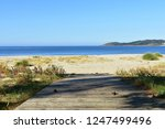 beach with boardwalk  golden...   Shutterstock . vector #1247499496