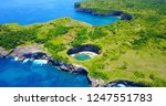 broken beach in nusa penida ... | Shutterstock . vector #1247551783