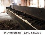 Broken Piano Inside Of...