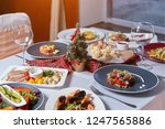 served festive table with lots... | Shutterstock . vector #1247565886