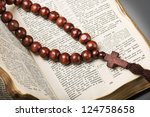 Wooden Rosary And The Bible On...