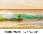 surfer on beautiful wave at... | Shutterstock . vector #124760284