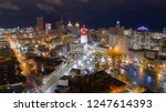 the buildings are illuminated... | Shutterstock . vector #1247614393
